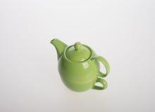 Комплект бака чая или чай фарфора бак и чашка на предпосылке Стоковое Изображение RF