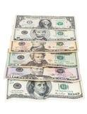 Комплект банкнот доллара на белой предпосылке Стоковое Изображение RF