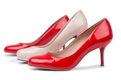 Комплект ботинок на белой предпосылке стоковые фото