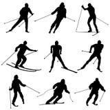 Комплект вектора silhouettes лыжники. Стоковое Изображение RF