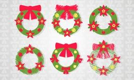 Комплект венка рождества с красным значком смычка с длинной тенью Стоковые Фото