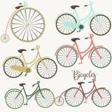 Комплект велосипедов вектора милых иллюстрация штока