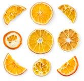 Комплект высушенных кусков и половины куска апельсина и лимона, изолированного на белизне Стоковая Фотография
