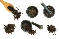 Комплект горячих изолированных семян черного перца Стоковая Фотография