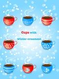 Комплект голубых и красных чашек с орнаментом снежинки Иллюстрация штока
