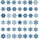 Комплект голубых снежинок вектора на белой предпосылке Стоковые Фотографии RF