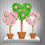 Комплект деревьев с розами и сердец в баках бесплатная иллюстрация