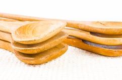 Комплект деревянной ложки на предпосылке ткани Стоковая Фотография