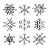 Комплект 9 значков снежинок вектора простых линейных Элементы дизайна битника черно-белые Стоковое Изображение