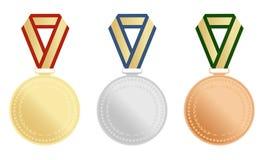 Комплект золота, серебр и бронза награждают медали на белой предпосылке также вектор иллюстрации притяжки corel Стоковое фото RF