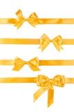 Комплект 4 золотых смычков подарка ленты Стоковое Фото