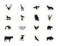 Комплект диаграмм и форм дикого животного при изолированные sunbursts на белой предпосылке Чернота silhouettes волк, олень, лоси Стоковое Изображение
