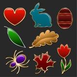 Комплект диаграмм сделанных в форме ювелирных изделий Сердце, кролик, яичко, тюльпан и листья различных деревьев обрамленных золо Стоковые Изображения