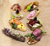 Комплект испанских тап на предпосылке тканей Большая предпосылка для ресторана, кафа Стоковая Фотография