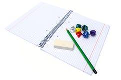 Комплект книги тренировки, карандаша, резины и dices изолированный на белизне Стоковое Фото