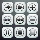 Комплект кнопок в белизне с черными значками на их o Стоковая Фотография