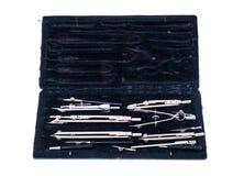 Комплект компасов металла чертежа в черном ящике Стоковые Изображения