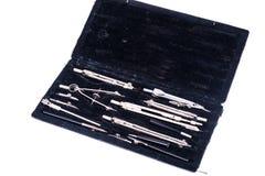 Комплект компасов металла чертежа в черном ящике Стоковое фото RF