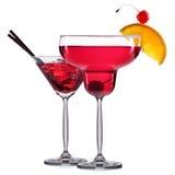 Комплект красных коктеилей с украшением от плодоовощей и красочной соломы изолированных на белой предпосылке Стоковая Фотография