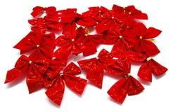 Комплект красных смычков ленты на белизне Стоковые Изображения