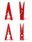 Комплект красных штырей одежд Раскрытый и закрытый, стоящ Стоковое Изображение RF