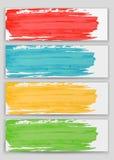 Комплект красочной щетки акварели штрихует краску на предпосылке карточек Стоковые Изображения