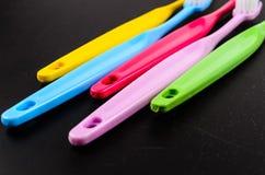 Комплект красочных toothbrushs Стоковые Изображения