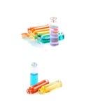 Комплект крошечных изолированных бутылок пробирки Стоковое Фото