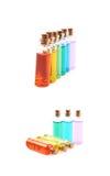 Комплект крошечных изолированных бутылок пробирки Стоковое фото RF