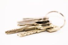 Комплект ключей с белой предпосылкой Стоковые Фото