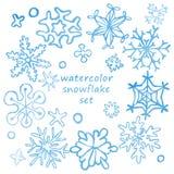 Комплект милых нарисованных вручную снежинок с текстурой акварели Стоковые Изображения RF