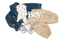 Комплект младенца одевает для мальчика на белой предпосылке Стоковая Фотография RF