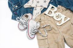 Комплект младенца одевает для мальчика на белой предпосылке Стоковые Фотографии RF