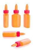 Комплект оранжевых бутылок клея от всех углов Стоковые Фото