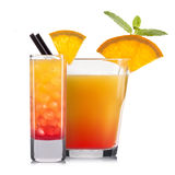 Комплект оранжевых коктеилей с украшением от плодоовощей и красочной соломы на белой предпосылке Стоковая Фотография RF