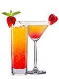 Комплект оранжевых коктеилей с украшением от плодоовощей и красочной соломы изолированных на белой предпосылке Стоковое Изображение RF
