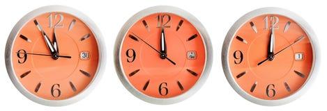 Комплект оранжевых циферблатов с полуночным временем Стоковые Фото