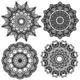 Комплект 4 орнаментов черного цвета круглых на белизне Стоковое фото RF
