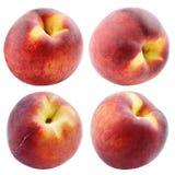 Комплект персиков изолированных на белизне Стоковые Фото