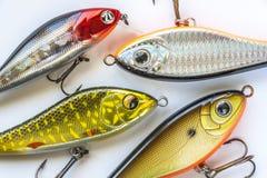 Комплект прикормов рыбной ловли на белизне Стоковая Фотография RF