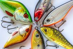 Комплект прикормов рыбной ловли на белизне Стоковая Фотография