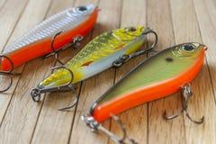 Комплект прикормов рыбной ловли на древесине Стоковое Изображение RF