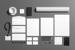 Комплект пустых канцелярских принадлежностей клеймя изолированный на серой предпосылке, месте с вашим дизайном Стоковая Фотография RF