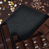 Комплект различного шоколада разнообразий на темной каменной предпосылке Стоковая Фотография
