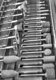 Комплект различных аксессуаров для мини машины сверла в черно-белом Стоковое Изображение