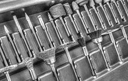 Комплект различных аксессуаров для мини машины сверла в черно-белом Стоковые Изображения RF
