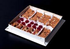 Комплект различных видов естественных десертов в коробке коробки Стоковые Изображения RF