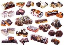 Комплект различных тортов изолированных на белой предпосылке Стоковые Фото