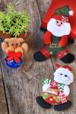 Комплект рождества декоративный на деревянной предпосылке Стоковые Изображения RF