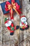 Комплект рождества декоративный на деревянной предпосылке Стоковое Изображение